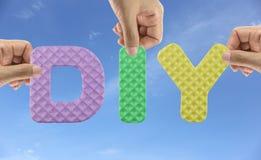 Hand arrange alphabet DIY of acronym Do It Yourself in Creative. Work pieces royalty free stock image