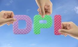 Hand arrange alphabet DPI of acronym Dot per Inch in matriculate Stock Photography