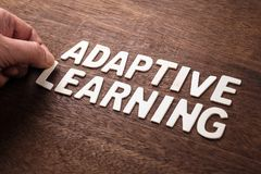 Adaptive Learning Letters. Hand arrange wood letters as ADAPTIVE LEARNING royalty free stock photo
