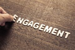 Engagement Word for Marketing Concept. Hand arrange wood letters as Engagement word for marketing concept Stock Photos