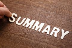Summary Wood Word. Hand arrange wood letters as Summary word Stock Images