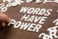 Words Have Power Letters. Hand arrange wood letters for text : Words Have Power with scattered wood letters Royalty Free Stock Image