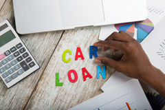 Hand arranging car loan Royalty Free Stock Photography