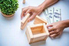 Hand arranging wood block Stock Photos
