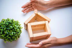 Hand arranging wood block Stock Images