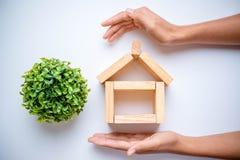 Hand arranging wood block Stock Photo
