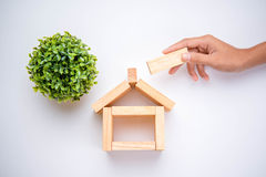 Hand arranging wood block Royalty Free Stock Photo