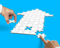 Hand with arrow shape puzzle Royalty Free Stock Image