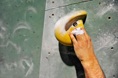Hand on artificial climbing wall Royalty Free Stock Images