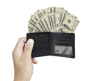 Hand as he is getting a banknote out of his wallet Royalty Free Stock Photography