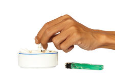 Hand and Ashtray with Cigarettes Royalty Free Stock Image