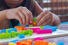 Hand assembled plastic blocks toy Stock Photos