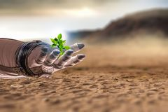There is life in space. Mixed media. Hand of astronaut and green sprout. Mixed media Royalty Free Stock Photos