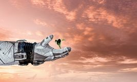 There is life in space. Mixed media. Hand of astronaut and green sprout. Mixed media Royalty Free Stock Photo
