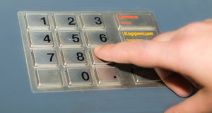 Hand and ATM keypad Stock Photos
