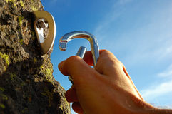 Hand Attaching Carabiner Royalty Free Stock Photography