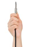 Hand with audio cable Stock Photography