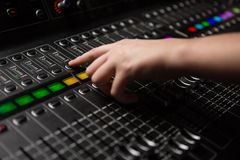 Hand of audio engineer using sound mixer Royalty Free Stock Photography