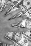 Hand auf Geld Lizenzfreies Stockbild
