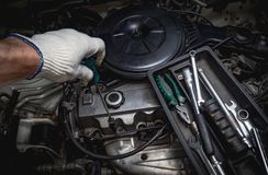 Hand of auto mechanic with a wrench. Royalty Free Stock Image