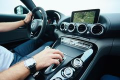 Hand on automatic gear shift, Man hand shifting an automatic car.  stock photos