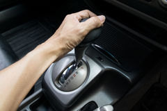 Hand on automatic gear shift Stock Photos