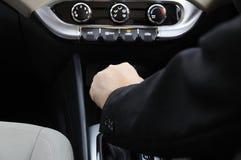 Hand On Automatic Shift Knob. Business man hand on automatic gear shift knob royalty free stock photography