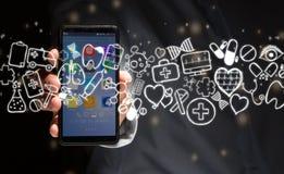 Hand av en hållande smartphone för man med medicinska symboler lite varstans Fotografering för Bildbyråer