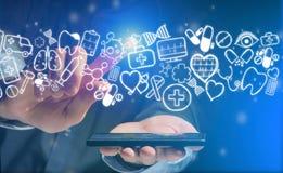 Hand av en hållande smartphone för man med medicinska symboler lite varstans Royaltyfria Foton