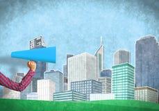 Hand av kvinnan som rymmer trumpeten för blått papper mot illustrerad bakgrund Arkivfoto
