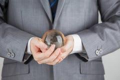 Hand av Person Very Gently Holds Globus Fotografering för Bildbyråer
