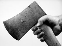 Hand and ax. Man's dirty  hand gripping ax Stock Photo