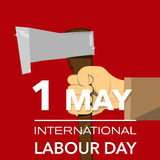 Hand with axe international labour day Stock Photography