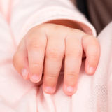 Hand of baby Stock Image