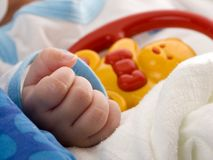 Hand with baby toy Royalty Free Stock Images
