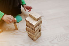Hand of baby who played developmental game of wooden blocks Stock Photography