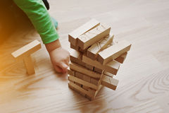 Hand of baby who played developmental game of wooden blocks Stock Images