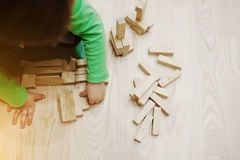 Hand of baby who played developmental game of wooden blocks Royalty Free Stock Photos
