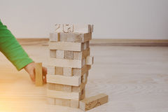 Hand of baby who played developmental game of wooden blocks Royalty Free Stock Photo