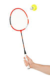 Hand with badminton racket and shuttlecock Stock Photo