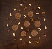 Hand-baked crisp biscuits with nuts top view wooden background Stock Image