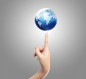 Hand and balance earth Royalty Free Stock Photos
