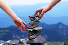 Hand Balanced Rock Tower, Mountain Background, Teamwork Concept Royalty Free Stock Photos