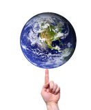Hand balancing earth on fingertip. Hand balancing planet earth on fingertip isolated on white. Some components of this montage are provided courtesy of NASA, and stock image