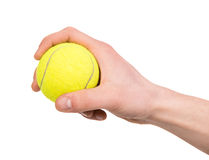 Hand with a ball. Hand holding tennis ball on white background Stock Photo