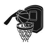 Hand with a ball near the basket.Basketball single icon in black style vector symbol stock illustration web. Stock Images