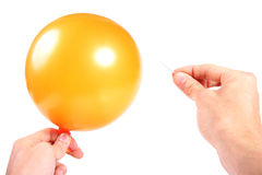 Hand with balloon and needle Royalty Free Stock Image
