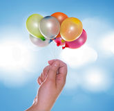 Hand with balloons Royalty Free Stock Image
