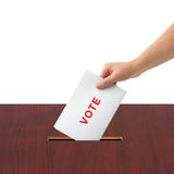 Hand with ballot and box. Isolated on white background Stock Photography