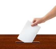 Hand with ballot and box Stock Photo